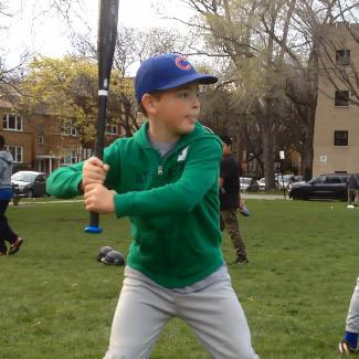 Back elbow up in young hitter's batting stance