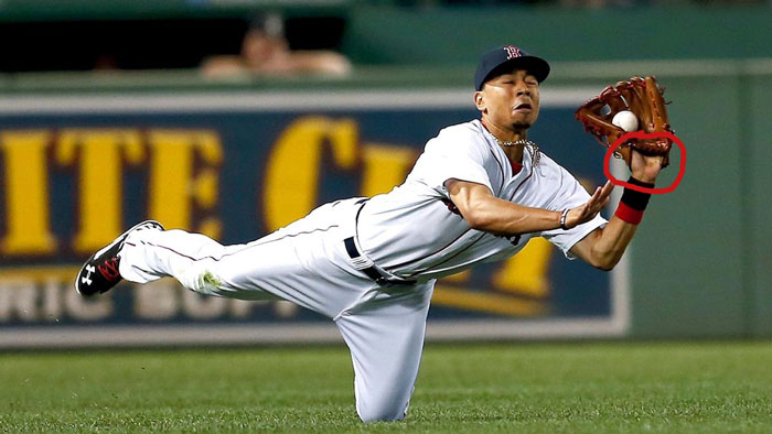 Red Sox right fielder Mookie Betts shows palm