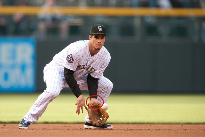 Rockies' third baseman Nolan Arenado showing palm